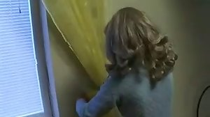 Rus Mom hang curtain with son. Fake Video